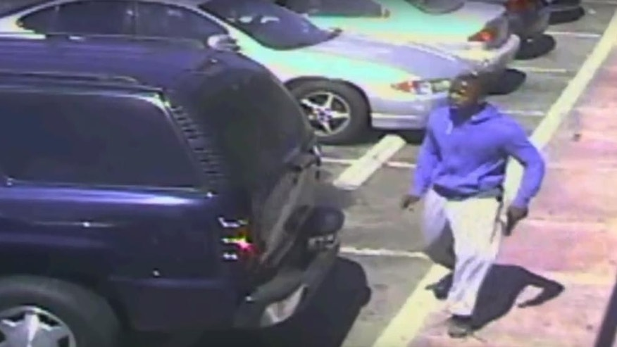 This Oct. 1, 2016 frame from security camera video, released by the Los Angeles Police Department and posted on its website on Oct. 4,  shows a suspect holding what appears to be a gun in the moments before he was fatally shot by officers in a police killing that has generated widespread protests.  Police said the video supports the account Chief Charlie Beck gave Monday justifying the  fatal shooting of Carnell Snell. Beck said Snell, 18, had a fully loaded semi-automatic handgun in one hand and turned toward officers when they fired.  (Los Angeles Police Department via AP)
