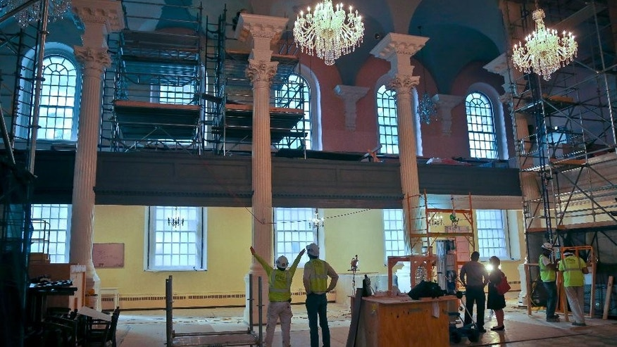 "In this photo taken Tuesday Aug. 9, 2016, work continues at St. Paul's Chapel during a months-long interior restoration in New York. The Episcopal sanctuary, Manhattan's oldest church, is getting ready to celebrate its 250-year history, which includes worshippers ranging from George Washington to those who searched for victims following the Sept. 11 attacks.  The renovation will be unveiled on its anniversary date Oct. 30, along with a ""9/11 Chapel of Remembrance"" area for quiet reflection that also contains artifacts of the attacks. (AP Photo/Seth Wenig)"