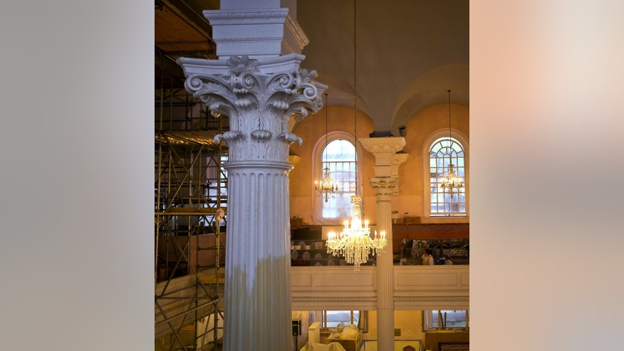 "In this photo taken Tuesday Aug. 9, 2016, a section of St. Paul's Chapel is shown during a months-long interior restoration in New York. The Episcopal sanctuary, Manhattan's oldest church, is getting ready to celebrate its 250-year history, which includes worshippers ranging from George Washington to those who searched for victims following the Sept. 11 attacks.  The renovation will be unveiled on its anniversary date Oct. 30, along with a ""9/11 Chapel of Remembrance"" area for quiet reflection that also contains artifacts of the attacks. (AP Photo/Seth Wenig)"