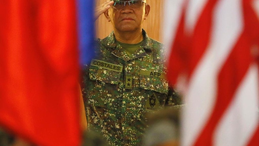 Maj. Gen. Andre Costales, Commandant of the Philippine Marines Corps, salutes the flags at the opening ceremony for the 33rd joint US-Philippines amphibious landing exercises dubbed PHIBLEX at the marines corps in Taguig city east of Manila, Philippines Tuesday Oct. 4, 2016. President Rodrigo Duterte said he was giving notice to the United States, his country's long-standing ally, that joint exercises between Filipino and American troops this week will be the last such drills. He told the Filipino community in Hanoi, Vietnam's capital, last week that he will maintain the military alliance with the U.S. because of the countries' 1951 defense treaty. But he said this week's exercises will proceed only because he did not want to embarrass his defense secretary.(AP Photo/Bullit Marquez)