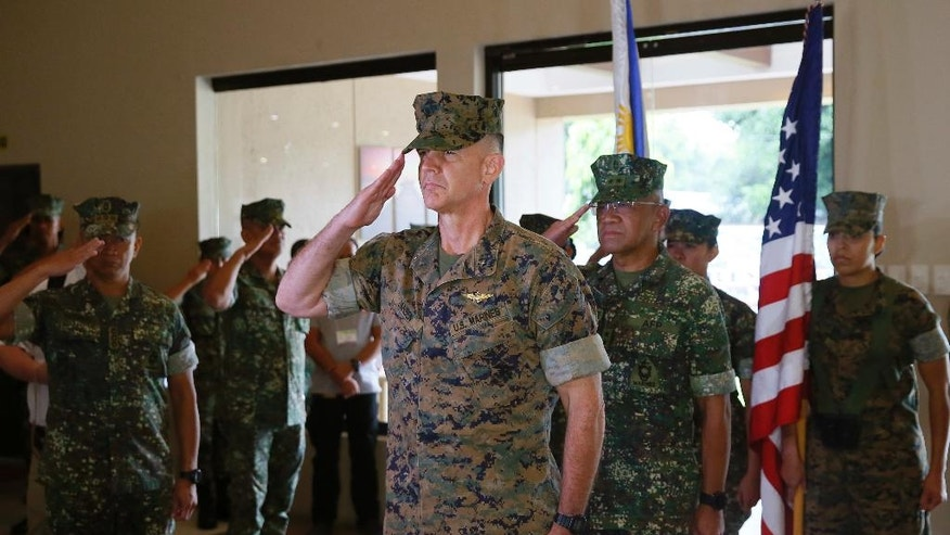 U.S. Marines Brig. Gen. John Jansen, center, of the 3rd Marine Expeditionary Brigade and Maj. Gen. Andre Costales, second from right, Commandant of the Philippine Marines Corps, salute at the opening ceremony for the 33rd joint US-Philippines amphibious landing exercises dubbed PHIBLEX at the marines corps in Taguig city east of Manila, Philippines Tuesday Oct. 4,2016. President Rodrigo Duterte said he was giving notice to the United States, his country's long-standing ally, that joint exercises between Filipino and American troops this week will be the last such drills. He told the Filipino community in Hanoi, Vietnam's capital, last week that he will maintain the military alliance with the U.S. because of the countries' 1951 defense treaty. But he said this week's exercises will proceed only because he did not want to embarrass his defense secretary.(AP Photo/Bullit Marquez)