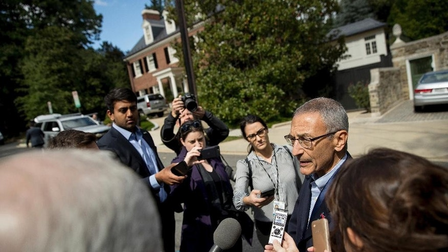"John Podesta, campaign manager for Democratic presidential candidate Hillary Clinton, talks to reporters outside Clinton's Washington home, Wednesday, Oct. 5, 2016. Podesta told reporters that the town hall setting for Sunday, Oct. 9, 2016, debate in St. Louis ""is a natural format for her.""  (AP Photo/Andrew Harnik)"