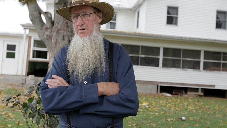 FILE - In this Oct. 10, 2011, file photo, Samuel Mullet Sr. stands in front of his home in Bergholz, Ohio.