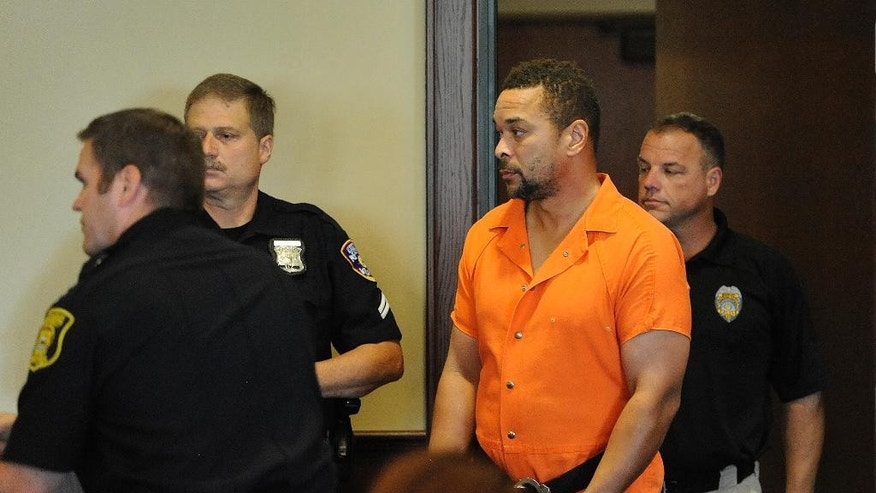 Gregory Green is escorted by court officers and Dearborn Heights police f his probable cause hearing before Judge Mark Plawecki  Wednesday, Oct. 5, 2016, at 20th District Court in Dearborn Heights, Mich. Green, an ex-convict, is accused of killing his two children and two older stepchildren at his suburban Detroit home. Green was released from prison in 2008 after serving 16 years for killing his pregnant first wife. He had pleaded no contest to second-degree murder.  (Jose Juarez/Detroit News via AP)