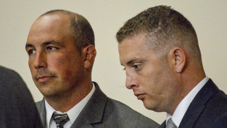 FILE - In this Aug. 18, 2015, file photo, former Albuquerque Detective Keith Sandy, left, and Officer Dominique Perez speak with attorneys during a preliminary hearing in Albuquerque, N.M.  Perez  took the stand Tuesday, Oct. 4, 2016,  to testify in his own defense, marking the first time either officer has spoken publicly about the 2014 shooting that killed 38-year-old James Boyd and derailed the officers' law enforcement careers. (AP Photo/Russell Contreras, File)
