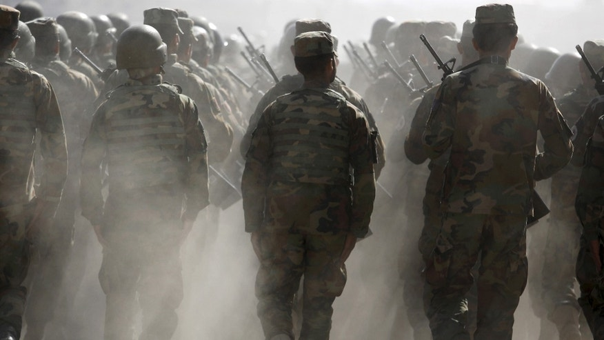 Afghan National Army officers marching during an exercise at the Kabul Military Training Center in Afghanistan.