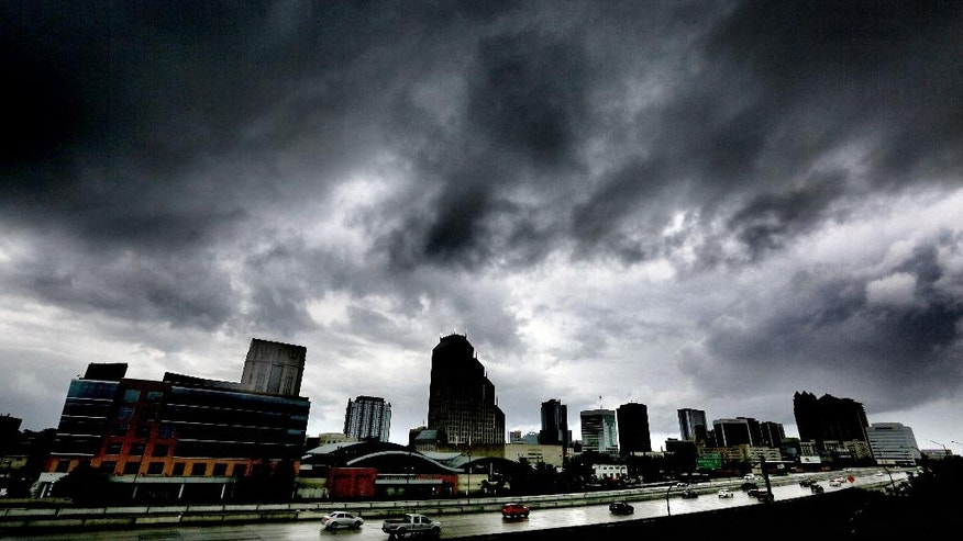 The first outer bands of rain from Hurricane Matthew pass over downtown Orlando, Fla., Thursday evening, Oct. 6, 2016. (Joe Burbank/Orlando Sentinel via AP)