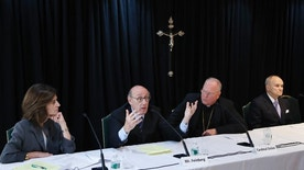 Kenneth Feinberg, second from left, speaks while Camille Biros, left, Cardinal Timothy Dolan, Archbishop of New York, second from right, and former New York City Police Commissioner Raymond Kelly listen during a news conference in New York, Thursday, Oct. 6, 2016. The news conference was to announce a new program intended to provide reconciliation and compensation for victims of sexual abuse by clergy; Feinberg and Biros will administer the independent program while Kelly is on the oversight committee. (AP Photo/Seth Wenig)