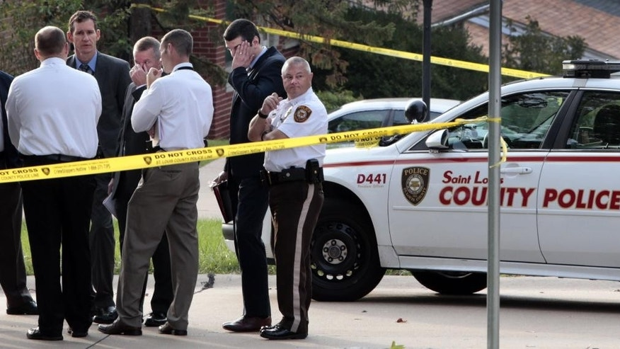 "St. Louis County officers investigate the scene where a fellow county officer and a suspect were shot early on Thursday, Oct. 6, 2016 on Arno Drive in Green Park Mo. Police spokesman Benjamin Granda says the officer and suspect are undergoing ""life-saving treatment"" following the pre-dawn shooting Thursday at a home in Green Park, a small middle class community in south St. Louis County. (Robert Cohen/St. Louis Post-Dispatch via AP)"
