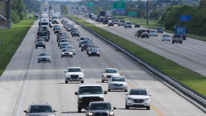 Northbound traffic on Interstate 95 flows northbound through Viera, Fla., as beachside residents evacuate in advance of Hurricane Matthew, Wednesday, Oct. 5, 2016. A spokeswoman for Florida's governor says about 1.5 million residents have been urged to leave their homes as Hurricane Matthew makes its way toward the state. Most of the counties along Florida's Atlantic coast have issued mandatory evacuations along the eastern most areas. (Craig Bailey/Florida Today via AP)