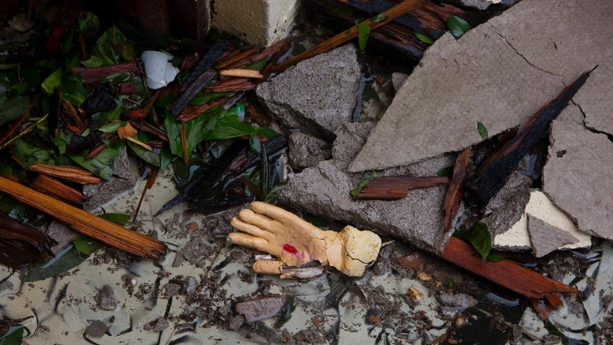 The hand of a statue lays in the rubbles of the Saint Anne church destroyed by Hurricane Matthew in Camp Perrin, a district of Les Cayes, Haiti, Thursday, Oct. 6, 2016. Two days after the storm rampaged across the country's remote southwestern peninsula, authorities and aid workers still lack a clear picture of what they fear is the country's biggest disaster in years. (AP Photo/Dieu Nalio Chery)