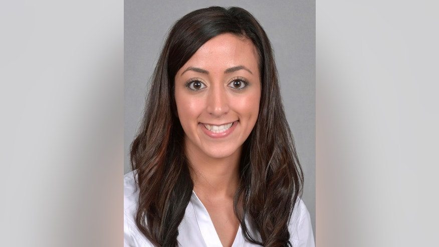 This 2012 photo provided by Northeast Ohio Medical University shows Tahani Mansour, died on Sept. 27, 2016 after being shot at her family's home in the Cleveland suburb of Rocky River, Ohio. Her father Jamal Mansour was indicted Wednesday, Oct. 5, 2016, on murder charges in his daughter's death. (Joseph Rudinec/Northeast Ohio Medical University via AP)