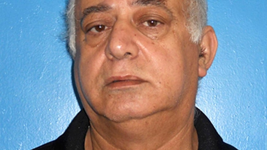 FILE - This September 2016 booking file photo provided by the Rocky River, Ohio, Division of Police shows Jamal T. Mansour in Rocky River, Ohio, charged with murder in the  Sept. 27 fatal shooting of his adult daughter Tahani Mansour at their suburban Cleveland home. Jamal Mansour was indicted on murder charges Wednesday, Oct. 5, 2016. (Rocky River, Ohio, Division of Police via AP, File)