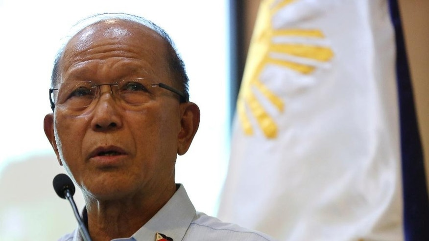 Philippine Defense Secretary Delfin Lorenzana speaks during a press conference at Camp Aguinaldo military headquarters in suburban Quezon city, north of Manila, Philippines Friday, Oct. 7, 2016. Lorenzana said Friday that he told the U.S. military that plans for joint patrols and naval exercises in the disputed South China Sea have been put on hold, the first concrete break in defense cooperation after months of increasingly strident comments by the country's new president. (AP Photo/Aaron Favila)