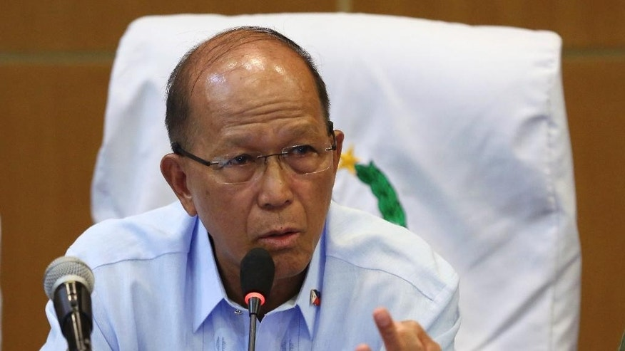 Philippine Defense Secretary Delfin Lorenzana gestures as he answers questions from reporters during a press conference at Camp Aguinaldo military headquarters in suburban Quezon city, north of Manila, Philippines Friday, Oct. 7, 2016. Lorenzana said Friday that he told the U.S. military that plans for joint patrols and naval exercises in the disputed South China Sea have been put on hold, the first concrete break in defense cooperation after months of increasingly strident comments by the country's new president. (AP Photo/Aaron Favila)