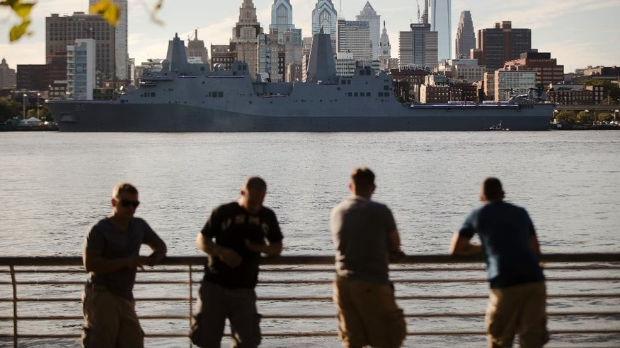 The USS John P. Murtha stands along the along the skyline of Philadelphia, on the Delaware River  Friday, Oct. 7, 2016.  The U.S. Navy is commissioning the USS John P. Murtha, a new ship named in honor of the late longtime Pennsylvania congressman and decorated Marine Corps veteran. Thousands are expected to honor Murtha on Saturday, Oct. 8, 2016 at Penn's Landing in Philadelphia during a ceremony to place the ship into active service.  (AP Photo/Matt Rourke)
