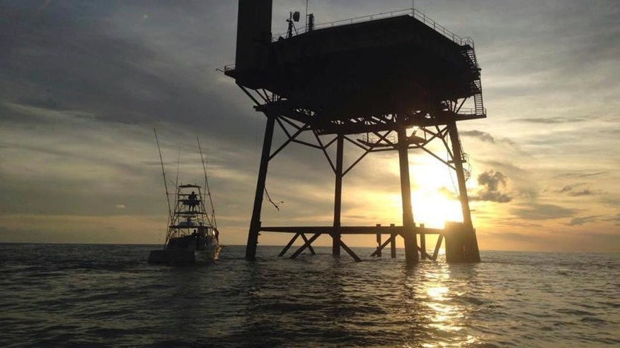 This photo provided by Jacob Jordan shows Frying Pan Tower. A North Carolina man and his fiancee are riding out Hurricane Matthew on top of the old Coast Guard light station more than 30 miles off the Atlantic coast. Richard Neal is the owner of Frying Pan Tower, a platform that is about 100 or so feet above the ocean, only reachable by helicopter or boat. While the 360-degree views of sunsets and sunrises are amazing, there's no land in sight. (Jacob Jordan via AP)