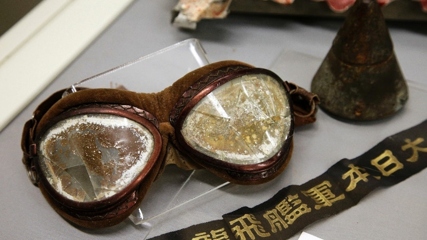 In this Tuesday, Oct. 4, 2016 photo a pair of goggles once worn by a Japanese pilot in the Dec. 7, 1941 attack on Pearl Harbor is on display part of an exhibit at The Museum of World War II, Boston, in Natick, Mass.