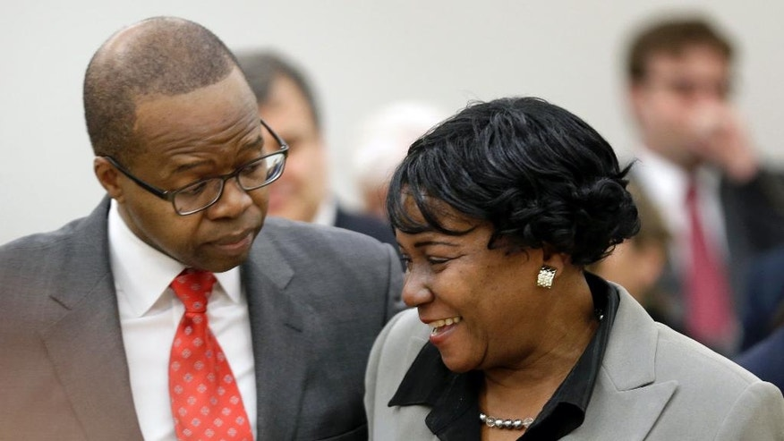 FILE - In this Feb. 23, 2016 file photo, Vanessa Gathers talks with Brooklyn District Attorney Ken Thompson after a hearing to vacate her wrongful conviction at Brooklyn Supreme Court in New York. Thompson, the first African-American to hold the office and whose career included internationally high-profile cases in private practice as well as a stint as federal prosecutor, died Sunday, Oct. 9, 2016, after a battle with cancer, just days after announcing he would be undergoing treatment. He was 50. (AP Photo/Seth Wenig, File )