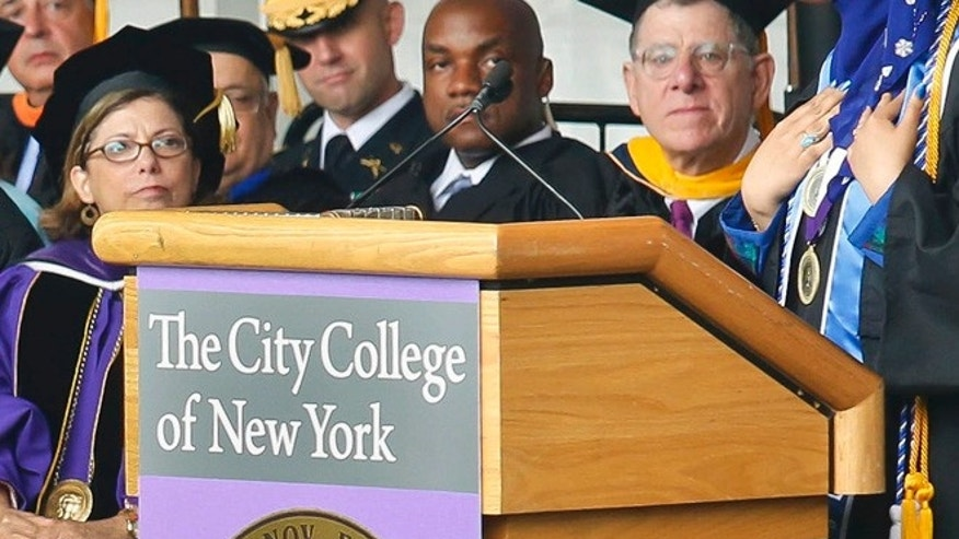 In this Friday, June 3, 2016, file photo, City College of New York (CCNY) President Lisa Coico sits while Class 2016 Salutatorian Orruba Almansouri address CCNY commencement in New York.