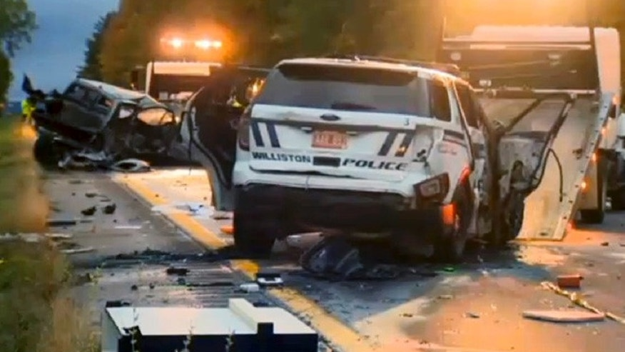 In this still image from video provided by WCAX-TV, workers remove vehicles from Interstate 89 early Sunday, Oct. 9, 2016, in Williston, Vt., after a wrong-way driver caused a crash just before midnight that killed multiple people, before stealing a police cruiser, striking several vehicles and injuring several people. 