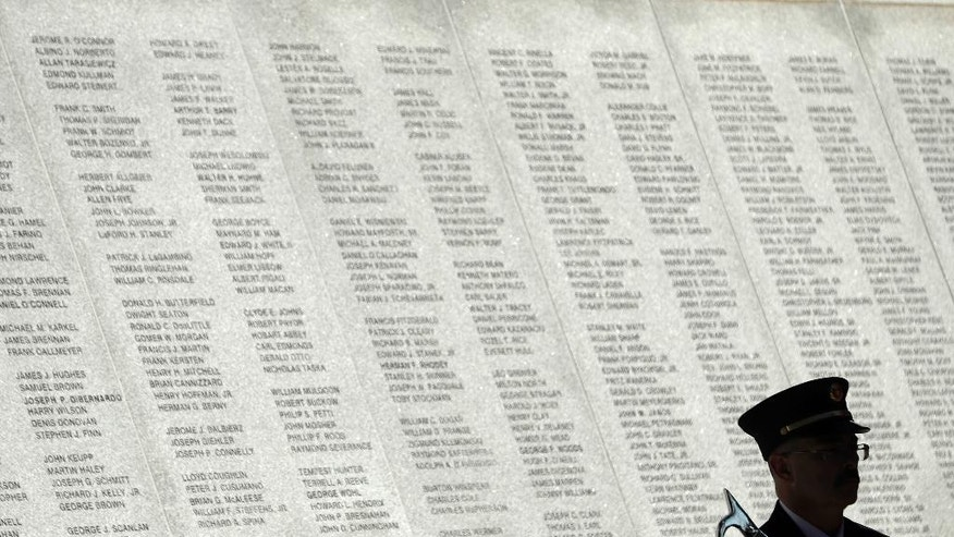 Christopher Taylor of the New York State Office of Fire Prevention and Control holds a pike pole during a ceremony at the New York State Fallen Firefighters Memorial at the Empire State Plaza on Tuesday, Oct. 11, 2016, in Albany, N.Y. The names of eight firefighters who died in the line of duty were added to the memorial. (AP Photo/Mike Groll)