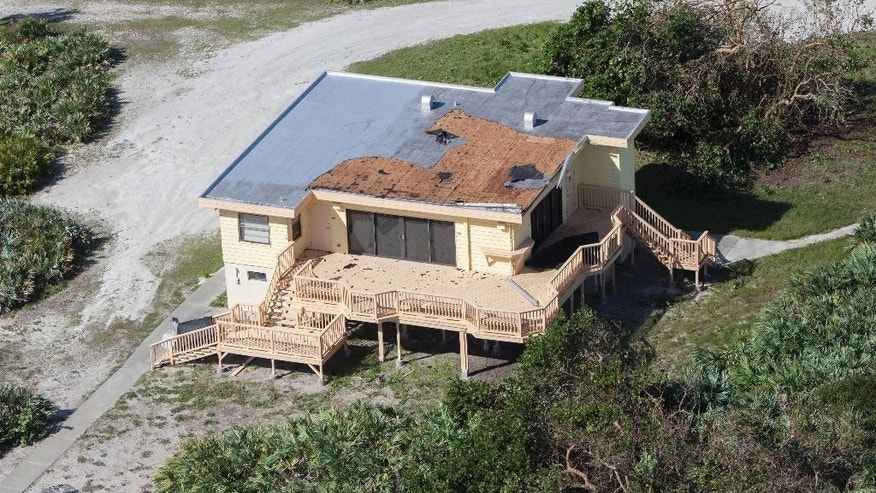 This Saturday, Oct. 8, 2016 photo provided by NASA shows damage to the roof of the Beach House during an aerial survey of the Kennedy Space Center in Florida. Hurricane Matthew passed to the east of the state on Oct. 6 and 7, 2016. (Cory Huston/NASA via AP)