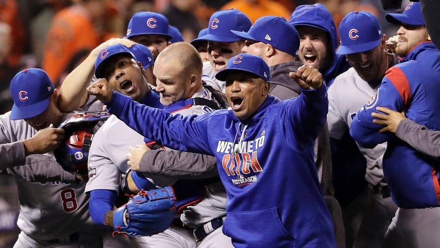 Chicago Cubs pitcher Aroldis Chapman, second from left, catcher David Ross, third from left, and teammates celebrate after Game 4 of baseball's National League Division Series against the San Francisco Giants in San Francisco, Tuesday, Oct. 11, 2016. The Cubs won 6-5. (AP Photo/Marcio Jose Sanchez)