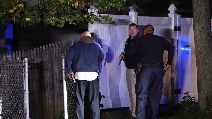Police search for a suspect after a shooting in the East Boston neighborhood of Boston, Wednesday, Oct. 12, 2016. Police say two officers were shot late Wednesday night. Their conditions were not immediately available. It's unclear what led to the shooting.(AP Photo/Charles Krupa)