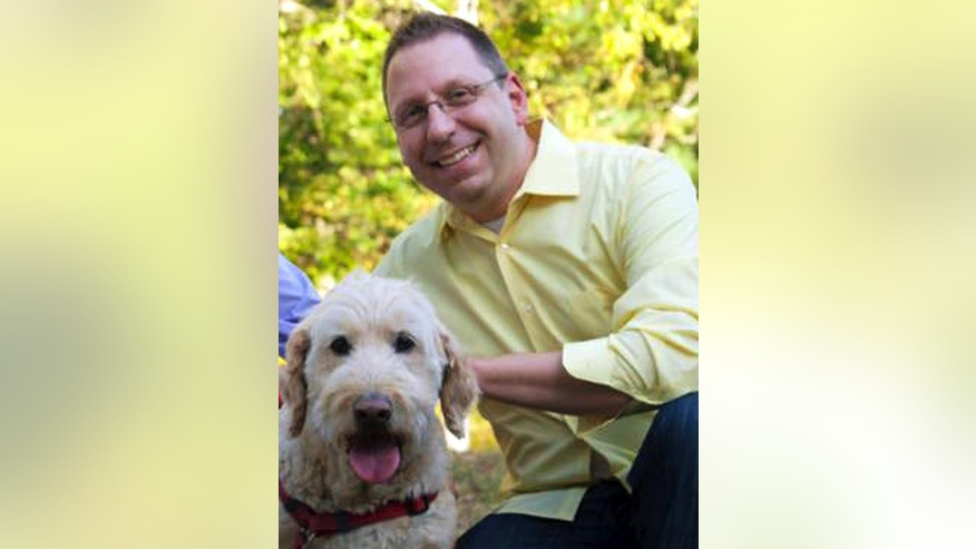"In this Sept. 2015 photo provided by Erin X. Smithers, Michael Templeton poses with his dog in Lincoln, R.I. Templeton, 38, said he was fired from his job as music director at the Church of St. Mary in Providence, a post he held for five years, after marrying his same-sex partner. An ideological tug of war over his firing illustrates the confusion in some U.S. Roman Catholic parishes over Pope Francis' words on homosexuality. The pope's declaration ""Who am I to judge?"" in 2013 energized Catholics who had pushed the church to accept gays and lesbians. Three years later, some gay Catholics and supporters who had hoped for rapid acceptance find themselves stymied by many bishops and pastors. (Erin X. Smithers via AP)"