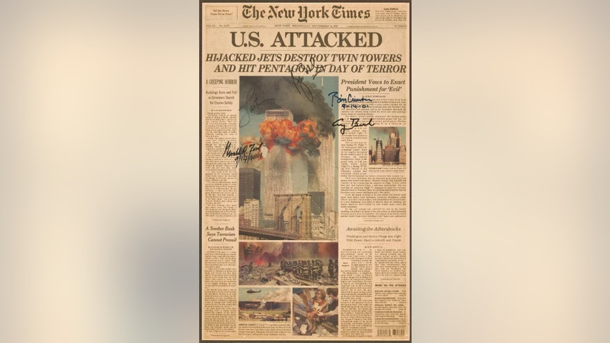 This undated photo provided by Lion Heart Autographs on Wednesday, Oct. 12, 2016 shows the front page of The New York Times newspaper from Sept. 12, 2001, autographed by five U.S. presidents _ Gerald Ford, Jimmy Carter, George H.W. Bush, Bill Clinton and George W. Bush - who were attending a national day of remembrance and prayer for 9/11 victims at the National Cathedral in Washington. Up for auction on Oct. 26, 2016, its pre-sale estimate is $6,000 to $8,000. (Lion Heart Autographs via AP)