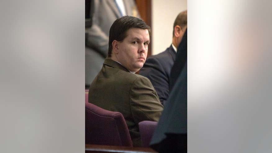 FILE- This Oct. 3, 2016, file photo shows Justin Ross Harris listening to jury selection during his trial at the Glynn County Courthouse in Brunswick, Ga.  The trial of Harris, accused of intentionally leaving his toddler son in a hot SUV to die, is being put on hold as Hurricane Matthew heads toward the Georgia coast where he is being prosecuted. Multiple news outlets report a judge said the trial of Justin Ross Harris would be in recess Thursday and Friday and then resume Monday. (Stephen B. Morton/Atlanta Journal-Constitution via AP, Pool, File)