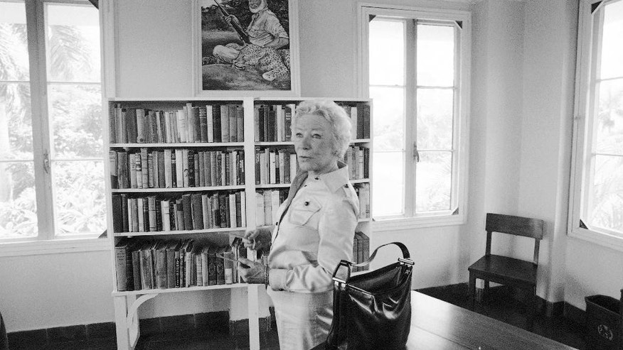 FILE - In this July 14, 1977, file photo, Mary Hemingway, widow of author Ernest Hemingway, tours the house they lived in during their stay in Cuba. A forum at the John F. Kennedy Presidential Library & Museum on Wednesday, Oct. 12, 2016, in Boston, will be held to discuss joint efforts in a U.S.-Cuba collaboration to preserve artifacts at Hemingway's former Cuban estate. (AP Photo/Charles Tasnadi, File)