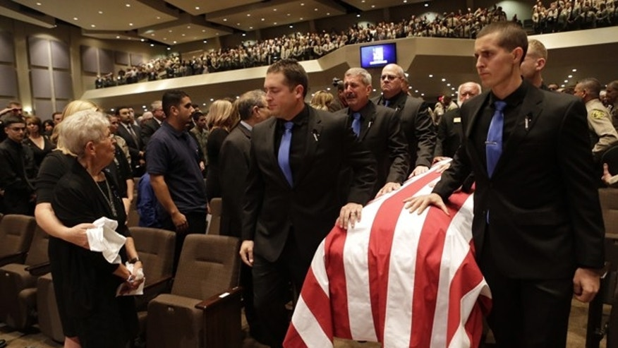 Thousands of law enforcement officials and members of the community gather for a memorial service of slain Los Angeles County Sheriff's Sgt. Steve Owen at Lancaster Baptist Church Thursday, Oct.13, 2016 in Lancaster, Calif.