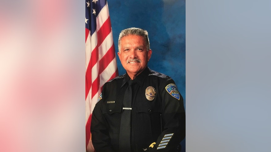 "In this photo released by the Palm Springs Police Department shows slain officer Jose ""Gil"" Gilbert Vega, a 35 year veteran who was killed in the line of duty Saturday, Oct. 8, 2016. Vega, the father of eight, planned to retire in December. (Palm Springs Police Department via AP)"