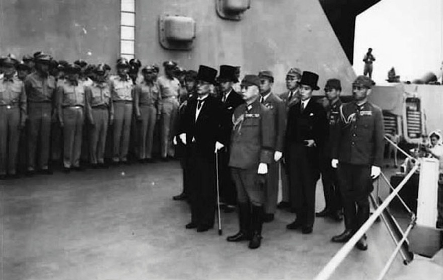 Japan's delegation gather to sign the formal surrender document on the U.S. Navy battleship USS Missouri in Tokyo Bay in a September 2, 1945 file photo. A ceremony to mark the 70th anniversary of Japan's formal surrender, marking the end of World War Two, is to be held Wednesday on the same battleship, now anchored at Pearl Harbor, Hawaii.  REUTERS/US Air Force/Handout via Reuters  THIS IMAGE HAS BEEN SUPPLIED BY A THIRD PARTY. IT IS DISTRIBUTED, EXACTLY AS RECEIVED BY REUTERS, AS A SERVICE TO CLIENTS. FOR EDITORIAL USE ONLY. NOT FOR SALE FOR MARKETING OR ADVERTISING CAMPAIGNS - RTX1QT4R