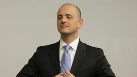 FILE - In this Aug. 27, 2016 file photo, independent presidential candidate Evan McMullin, participates in a staff meeting near Salt Lake City. The usual cohesion of voters in the conservative, Republican stronghold of Utah has been blown up this election season by Donald Trump's brashness and volatility, creating unprecedented uncertainty for a state that has been a shoo-in for GOP presidential candidates for a half century.  (AP Photo/Rick Bowmer, File)