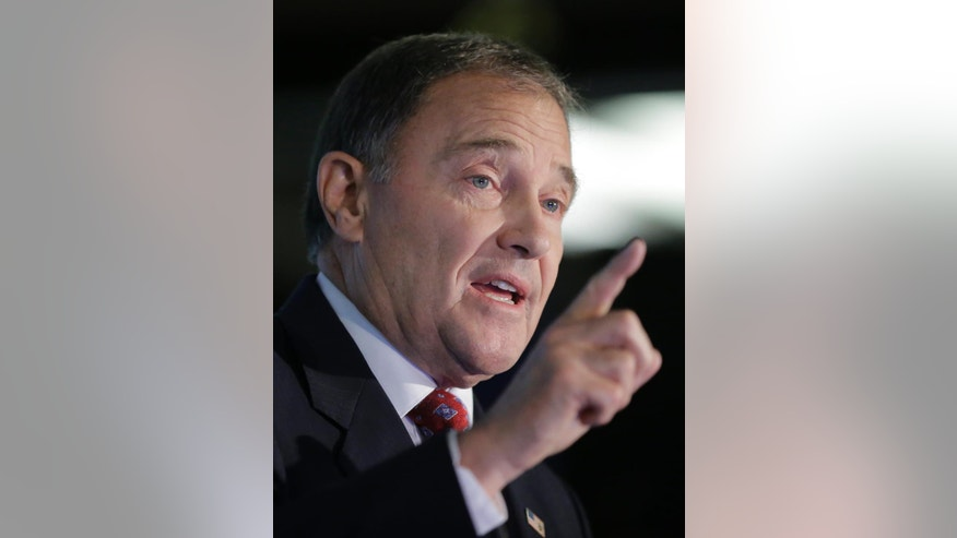FILE - In this Sept. 16, 2016 file photo, Utah Gov. Gary Herbert speaks at a debate in Salt Lake City. The usual cohesion of voters in the conservative, Republican stronghold of Utah has been blown up this election season by Donald Trump's brashness and volatility, creating unprecedented uncertainty for a state that has been a shoo-in for GOP presidential candidates for a half century.  (AP Photo/Rick Bowmer, File)