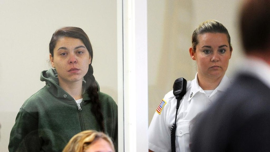Brittany Smith, left, appears at Orange District Court in Orange, Mass., for her arraignment on murder and other charges, Friday, Oct. 14, 2016. Smith is one of two suspects in the killing of a 95-year-old Massachusetts man during a home invasion. (Dave Roback /The Republican via AP, Pool)