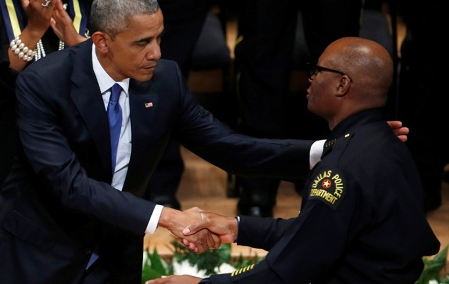 U.S. President Barack Obama shakes hands with Dallas police chief David Brown during a memorial service following the multiple police shootings in Dallas, Texas, U.S., July 12, 2016.  REUTERS/Carlo Allegri - RTSHMR1