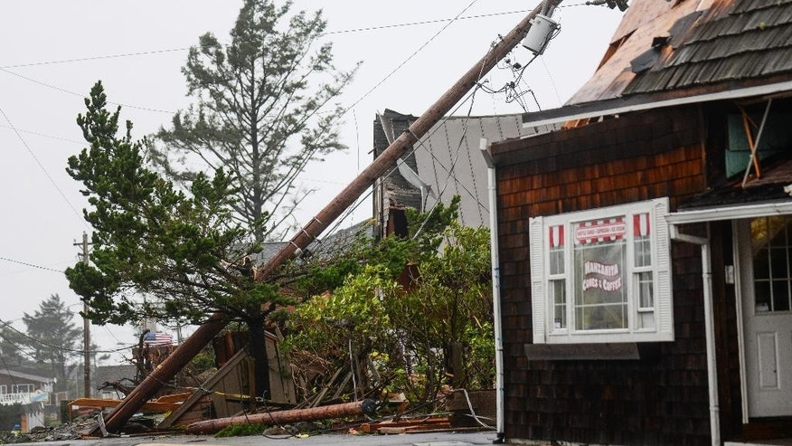 Storm debris lays along Laneda Ave, on Friday, Oct. 14, 2016, in Manzanita, Ore. A tornado struck the Oregon beach town as strong winds and heavy rain walloped the Pacific Northwest, leaving thousands without power as utility crews prepare for what's expected to be an even rougher storm on Saturday. (Danny Miller/Daily Astorian via AP)