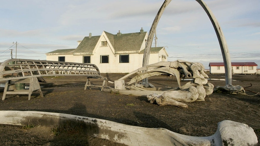 ILE - In this Aug. 12, 2005, file photo. a skin boat display sits next to whale bones and an arch made of a whale jaw on the beach at Brower's Cafe in Barrow, Alaska.