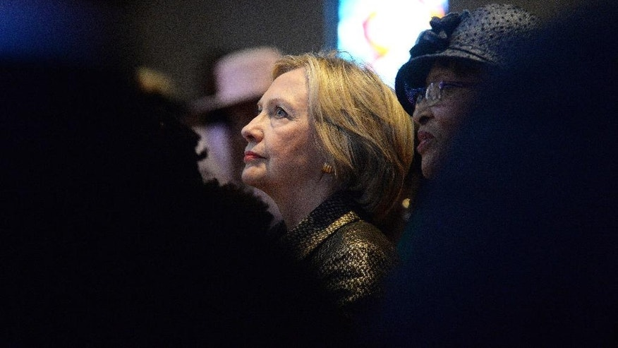 "FILE - In this Sunday, Oct. 2, 2016 file photo, Democratic presidential candidate Hillary Clinton listens to a sermon after speaking at Little Rock AME Zion church in Charlotte, N.C., fewer than two weeks after the shooting death of Keith Lamont Scott touched off two nights of violent protests in the city's downtown. At a presidential forum in 2007, Clinton said, ""I take my faith very seriously and very personally. And I come from a tradition that is perhaps a little too suspicious of people who wear their faith on their sleeves ... a lot of the talk about and advertising about faith doesn't come naturally to me."" (Diedra Laird/Charlotte Observer via AP)"