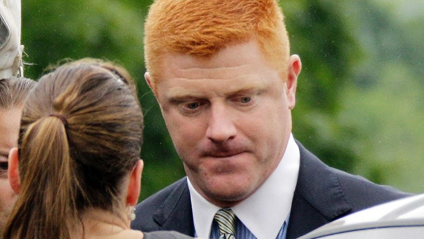 FILE - In this June 12, 2012, file photo, former Penn State University assistant football coach Mike McQueary arrives at the Centre County Courthouse in Bellefonte, Pa. McQueary's defamation and whistleblower lawsuit against Penn State over how it treated him for complaining about assistant football coach Jerry Sandusky sexually abusing a boy in a team shower is scheduled to go to trial Monday, Oct. 17, 2016, with opening statements in a courthouse near the university campus. (AP Photo/Gene J. Puskar, File)