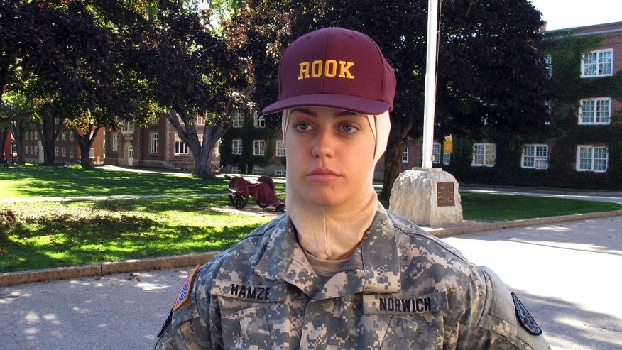 "In this Oct. 12, 2016 photo, freshman student Sana Hamze poses in Northfield, Vt., during an interview about her time as a ""rook,"" or first year student in the military college's Corps of Cadets. Norwich University has allowed Hamze to wear her Muslim headscarf as part of her Norwich uniform. Hamze chose Norwich after another military school refused to change its uniform code to accommodate her request. (AP Photo/Wilson Ring)"
