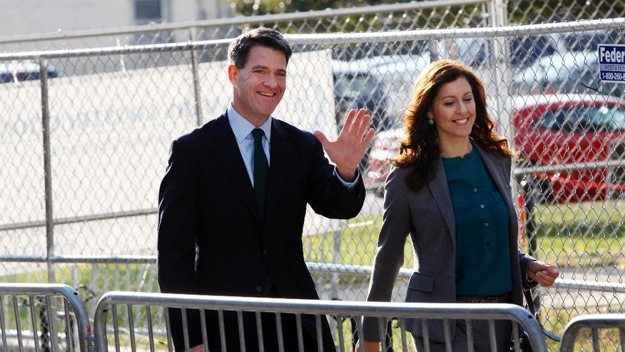 Bill Baroni waves as he arrives with his attorney Jennifer Mara, right, at Martin Luther King Jr. Federal Courthouse for a hearing, Monday, Oct. 17, 2016, in Newark, N.J. Three years after gridlock paralyzed a New Jersey town next to the George Washington Bridge for days, two former allies of Christie, Baroni and Christie's former Deputy Chief of Staff Bridget Anne Kelly, are being tried on charges of politically motivated lane closures of the George Washington Bridge in 2013. (AP Photo/Mel Evans)