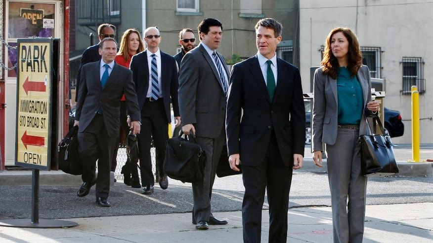 Bill Baroni, second right, and his attorneys Jennifer Mara, right, and Michael Baldassare, third right, arrive at Martin Luther King Jr. Federal Courthouse for a hearing, Monday, Oct. 17, 2016, in Newark, N.J. Three years after gridlock paralyzed a New Jersey town next to the George Washington Bridge for days, two former allies of Christie, Baroni and Christie's former Deputy Chief of Staff Bridget Anne Kelly, are being tried on charges of politically motivated lane closures of the George Washington Bridge in 2013. (AP Photo/Mel Evans)