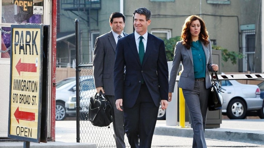Bill Baroni, second right, walks with his attorneys Jennifer Mara, right, and Michael Baldassare, left, as they arrive for a hearing, Monday, Oct. 17, 2016, in Newark, N.J. Three years after gridlock paralyzed a New Jersey town next to the George Washington Bridge for days, two former allies of Christie, Baroni and Christie's former Deputy Chief of Staff Bridget Anne Kelly, are being tried on charges of politically motivated lane closures of the George Washington Bridge in 2013. (AP Photo/Mel Evans)