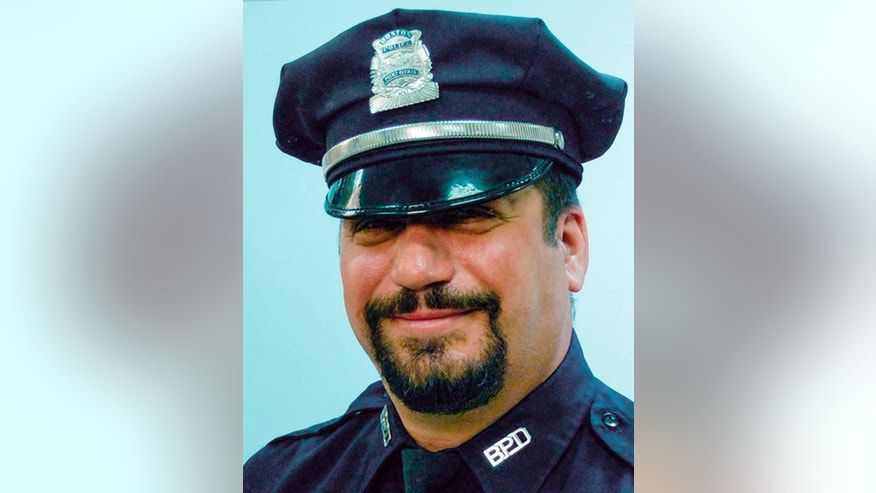 This undated photo released Thursday, Oct. 13, 2016, by the Boston Police Department shows Officer Richard Cintolo, one of two officers shot in the East Boston neighborhood late Wednesday night while responding to a report of a domestic disturbance. Cintolo, a 27-year veteran of the department, and fellow officer, Matt Morris, have been upgraded to stable condition. (Boston Police Department via AP)