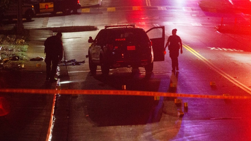 Oct. 16, 2016: Vallejo Police officers work at the scene of a shooting in Vallejo, Calif.
